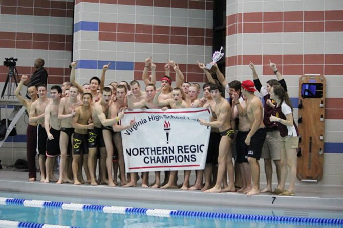 Both the Oakton girls' and Oakton boys (pictured) awim teams were crowned Northern Region champions this past Saturday night at Oak Marr Recreation Center.