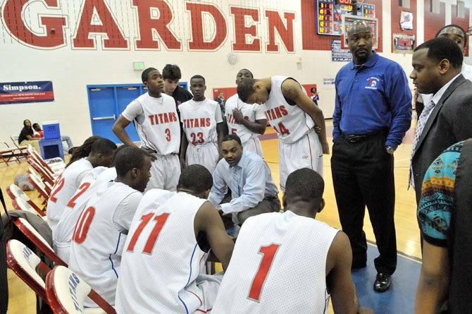 T.C. Williams boys' basketball coach Julian King talks to the Titans during a game against Lake Braddock on Feb. 7 at The Garden.