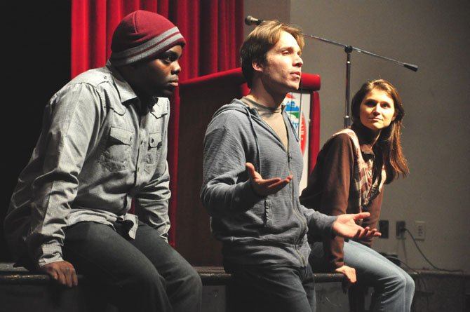 From left, Kervin Germain, Casey Preston and Amie Cazel of Deana's Educational Theater speak about the realities of teen dating abuse at McLean High School Thursday, Feb. 9.