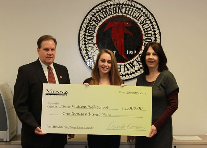 Pictured left to right: Mark Merrell, principal of James Madison High School; Maddie Hovis, winner of Vienna Shopping Center Shopping Spree; Brenda Bonds, marketing associate of The Rappaport Companies.