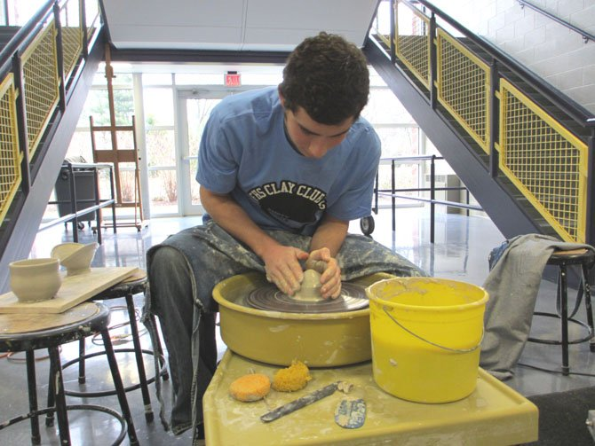 William Chanania, a Flint Hill senior, gives a demonstration on throwing clay. All components, including glaze, are safe, he said.
