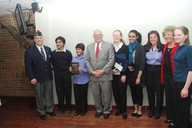 From left: Commander Gary Kelch of VFW Post 7327, third place Patriot's Pen winner Nithin Bagal, first place Patriot's Pen winner Paarth Jain, U.S. Rep. Gerry Connolly, second place Voice of Democracy winner Gwendolyn Cardiff, first place Voice of Democracy winner Hanan Awel, teacher of the year Sheila Bruen, Ladies Auxiliary President Linda Bond, and third place Voice of Democracy winner Megan Marriott.