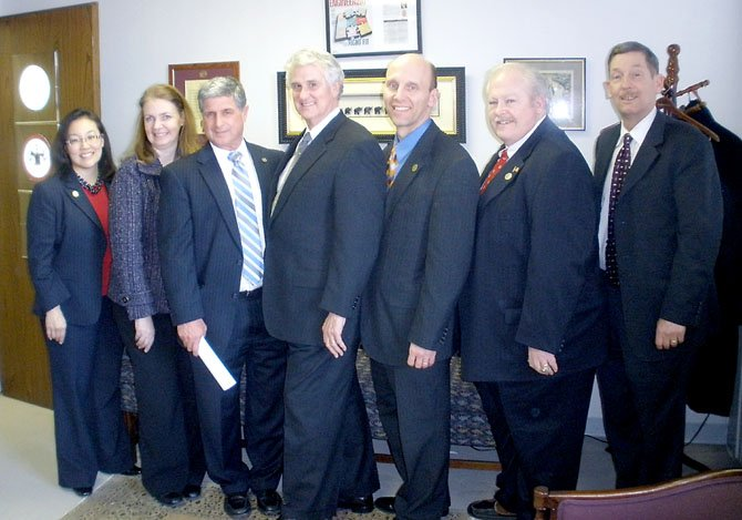 From left: Councilmember Grace Wolf, Councilmember Connie Hutchinson, Town Manager Art Anselene, Delegate Tom Rust, Mayor Steve DeBenedittis, Councilmember Bill Tirrell, and Town Attorney Richard Kaufman.
