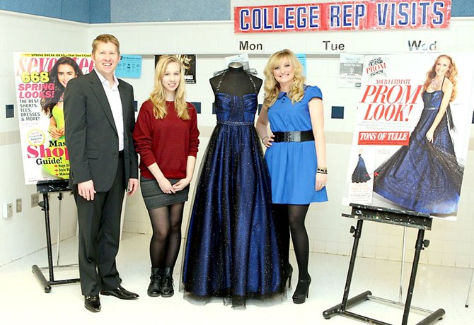 Samantha Bryant (middle) posed with the prom dress shed created, along with Brian Beitler and Lis Rockey of Davids Bridal.  