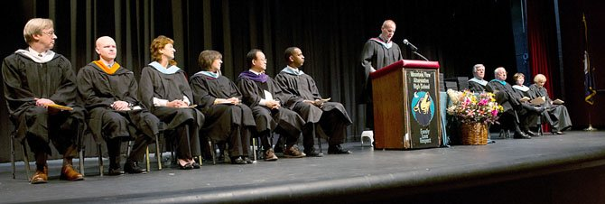 Several members of the Fairfax County School Board and senior administrators participated in Mountain View Alternative High Schools winter graduation. Seated, from left to right: School Board Member At Large Ted Velkoff, School Board Member At Large Ryan McElveen, Providence District School Board Member Patty Reed, Sully District School Board Member Kathy Smith, Vice Chairman of the School Board Ilryong Moon, Mountain View High School Principal Dave Jagels (standing), Fairfax County Public Schools Superintendent Dr. Jack Dale, COO Facilities and Transportation Services of FCPS Dean Tistadt, FCPS Assistant Superintendent Dr. Kim Dockery, and Fairfax County Division Counsel Anne Murphy. Also in attendance was Linda Burke, assistant superintendent of Cluster VII.