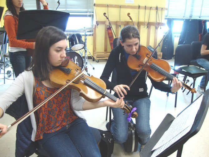 Sarah White and Kathlyn Silverman, violas.