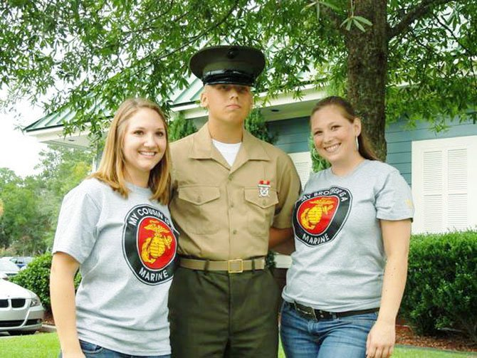 PFC Daniel Kellam on graduation day from boot camp on Parris Island, S. C. on Sept. 16. He is standing with his cousin, Heather Gillespie (left) and sister, Kristen Kellam (right).