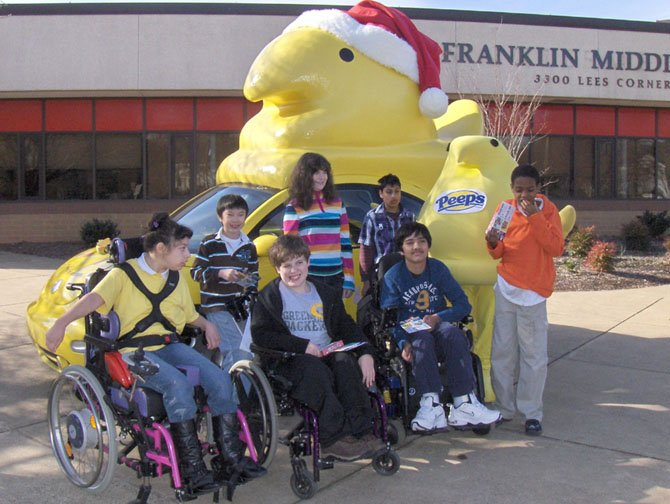 Posing with the Peeps Mobile are students in Franklin's special-needs program. (Back row, from left) are Alex Nguyen, Lotti Wiltse and Adithya Mathuria, and (front row, from left) are Joeylin Caracoglia, Josh Cibula, Bharat Danturthy and Isaiah Thompson (standing).