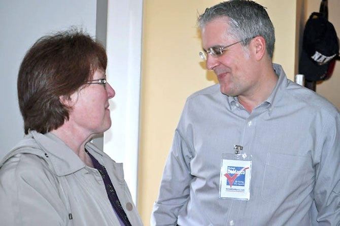 Michael DeMarco greets a guest at his open house on Sunday, Feb. 20. He is running for a Fairfax City Council seat.