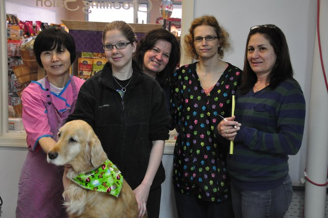 The staff of Great Dogs of Great Falls, which offers pet food, toys, accessories and grooming services.