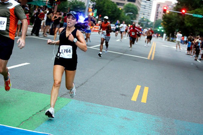 Arlington resident Abbe Burdetsky prepares for the 23rd annual Dana-Farber Marathon Challenge in Boston.