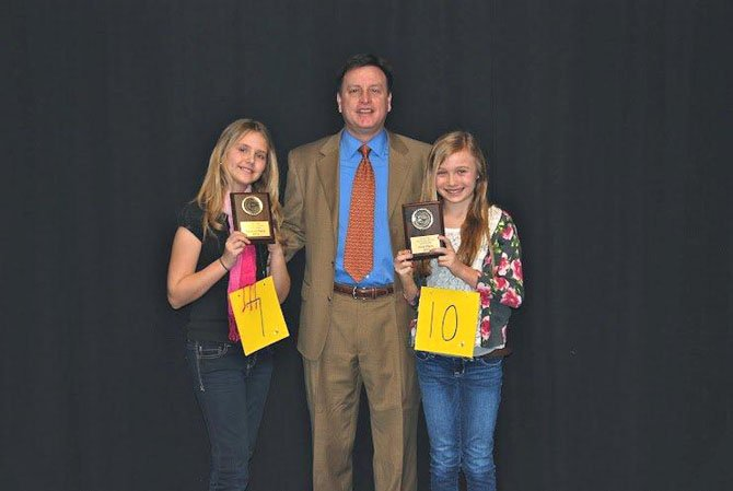 Katherine Mansourova (2nd place), Ernest Leighty (Great Falls Elementary School Principal) and Sophia Divone (1st place). Divone will move onto Regional Spelling Bee event on March 18.