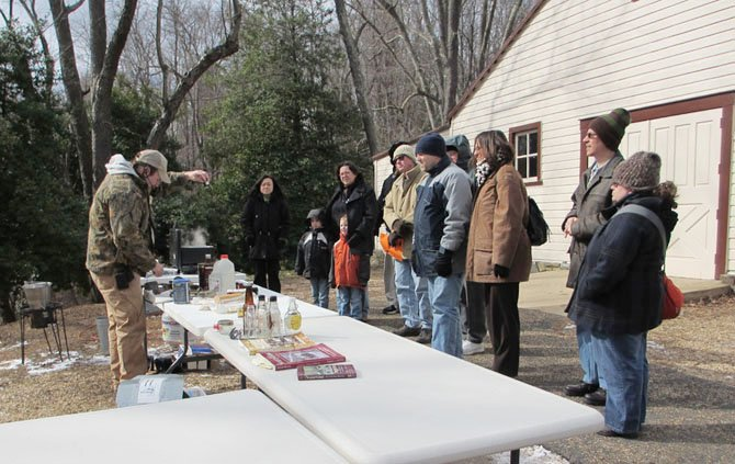 Guests bundled up for the cold to watch the maple syrup boil-down demonstration at Colvin Run Mill.