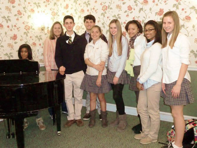 Gabby McIntosh, (at the piano) Dr. Sara Romeyn, Justin Schuble, Max Bramson, Jessica Mays, Allison Leasure, Chandler Bryant, Amala Nixon and Sarah Bair volunteer at Manor Care.