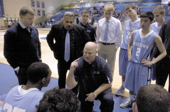 Yorktown boys basketball coach Rich Avila talks to the Patriots during their regional quarterfinal matchup with Fairfax on Feb. 22.