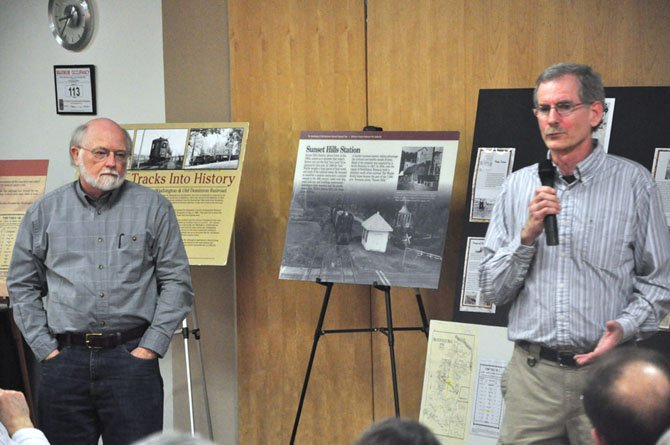 From left, Ron Beavers and Paul McCray tell the story of the Washington and Old Dominion Railroad at the Reston Community Center Lake Anne Thursday, Feb. 23.