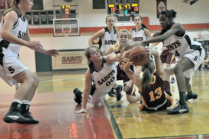 St. Stephen's & St. Agnes' Alexis Sargent (00) and Dhyamond Crenshaw, right, go after the ball, which is controlled by Bishop Ireton's Isabelle Kendall on Feb. 28.