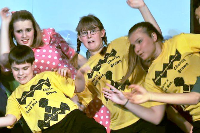 The Peanuts gang sticks together during dress rehearsals last week. From left, Sarah Miller, a freshman at Robinson Secondary School; Andrew Giddings, a seventh-grader at Irving Middle School; Katie Tisler, an eighth-grader at Lake Braddock Secondary School; and Taryn Falkenstein, a freshman at Robinson.