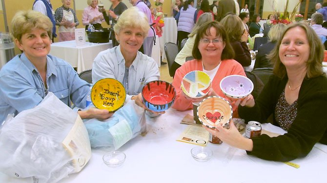 Friends Carol Valentine and Tori Beuzese of Lorton, Alicia Preito and and Chris Cohen of Fairfax show off the bowls they selected at the Empty Bowls fundraiser.