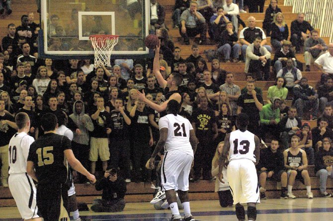 With the Westfield student body cheering him on, Zach Elcano goes up for a close range score in the title game that was played at Robinson.
