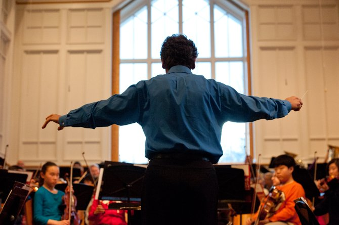 Fairfax Symphony Orchestra Music Director and Conductor Christopher Zimmerman conducts members of the American Youth Philharmonic Orchestras in a special side-by-side rehearsal with 28 members of the Fairfax Symphony Orchestra on Feb. 25 at the Vienna Presbyterian Church.