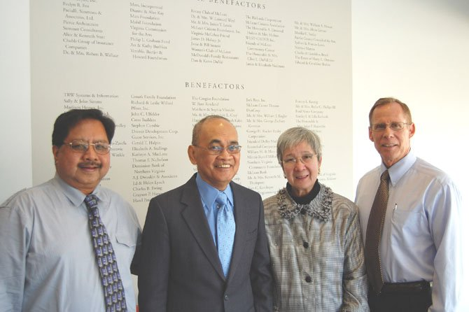 MCC Comptroller Bob Taguding, Roberto M. and Gloria M.T. Federigans and MCC Executive Director George Sachs in front of  the MCC Benefactors' Wall.