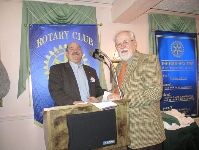 Rotarian Howard Svigals, who nominated Healing Waters as a Rotarian donation recipient, presents check to Healing Waters CEO Warren Phillips.