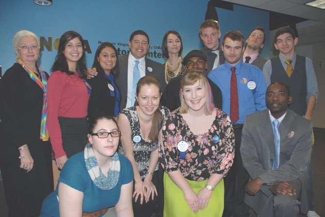 Members of Prof. Rosemarie Pelletier's American National Politics class who presented Democrat and Republican party platforms and candidates in a mock convention. Back row, from left: Prof. Pelletier, Greysi Vasquez, Rosa Alfaro, Helder Barberena, Sarah Wright, Dan Cook, Robert Kuehn, Zach Miller; middle row: Brandon Cheltenham and Will Harrison: front row: Ariel Lang, Leah Beyers, and Errik Hopkins.