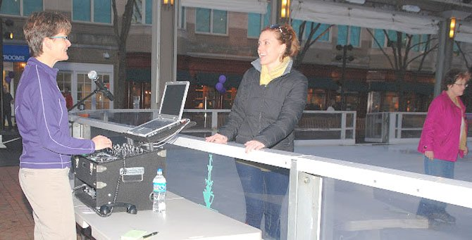 "Pavilion Ice Rink DJ Peggy Castle discusses music with skater Melissa Reiter during the ""March for Babies"" Fundraiser."