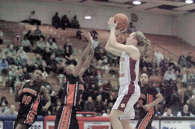 Katherine Coyer scored 12 of her 22 points during the third quarter of the Cougars' win over Monacan.