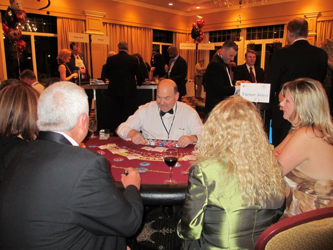 Rotarian Howard Svigals deals at a blackjack table.