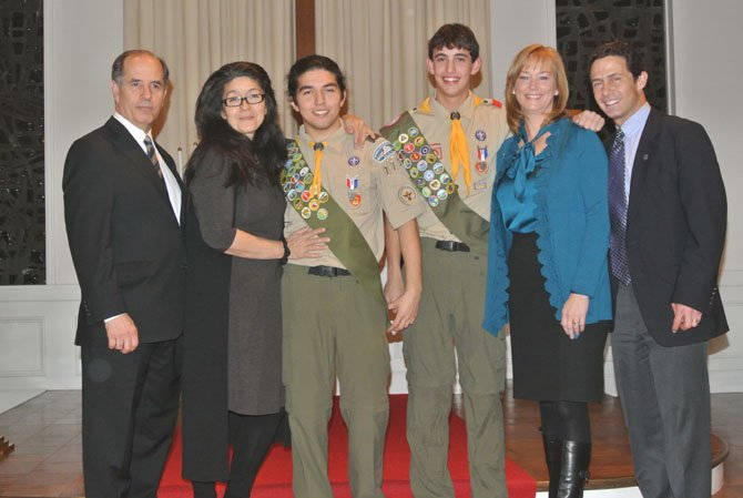 From left, parents Jim and Maria Fusco with Eagle Scout Michael Fusco, and Eagle Scout Jeff Bass with parents Pam and Barry Bass.