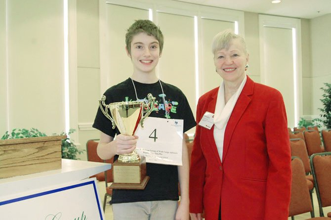Spelling Bee champion Reid FitzHugh with bee sponsor Carolyn Meakem of The Meakem Group of Wells Fargo Advisors.