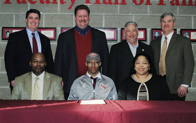 Moses Webb, bottom row, middle, was one of five Bishop Ireton seniors to sign national letters of intent to play college sports.