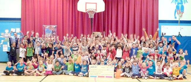 MCM Fun Run participants from George Mason Elementary School celebrate their Healthy School Award March 1. The school had 243 students participate in the run, which placed them in the top 5 and earned the PE department a check for $1,000.
