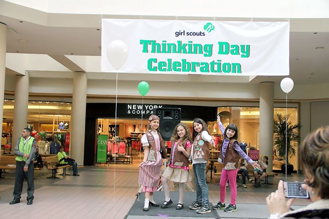 Striking poses, Gracyn Redding, Amelie Mohn, Autumn Arencibia and Camila Lopez, members of Brownie Troop 6320 from Rolling Valley Elementary School in Springfield, enjoyed performing a skit about Germany on the main stage when area Girl Scouts recognized their 100th Anniversary during a special Thinking Day Celebration at Springfield Mall on Saturday, Feb. 18.