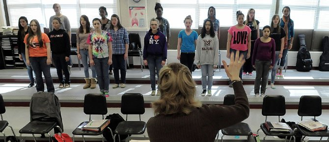 "Choral director Judith Belzer leads the advanced women's chorus in ""Veni, Sancte Spiritus"" by Andrea Ramsey. The chorus members are: Desha Brown, Sarah Busch, Lily Chong, Rebecca Dyson, Lizett Giron, Elizabeth Gregory, Savanna Lindsay, McKenzie Moore, Gilda Nimoh, Elle Parks, Catherine Perryman, Aylana Randall, Catherine Ray, Gabrielle Salvado, Brooke Scutt, Alliyah Stevens, Ashley Vanlandingham, Jessica Viera, De'ja Wanzer and Gabrielle Wineberger."