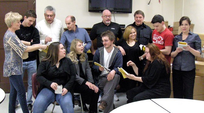 Members of The Alliance Theatre portray the cast of a summer-repertory company rehearsing for a show.