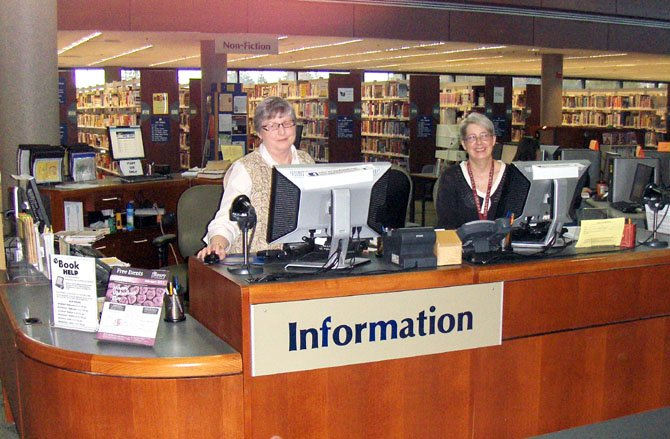 Pam Rearden (left), children's information assistant, and librarian Jaye Lahlou at the centrally relocated information desk.