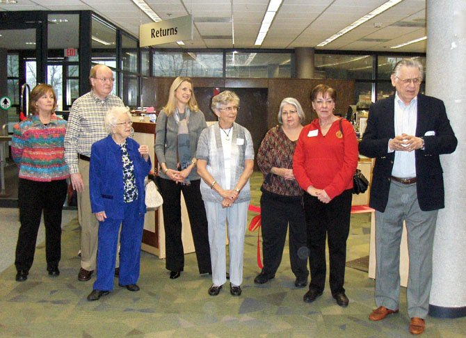 Listening to their president John Finneman (at far right) speak during the Feb. 29 ceremony are Chantilly Friends and board members (from left) Elise Serrano, Dave Price, Rosannah Moser, Nora Britch, Lois Price, Bonnie Dinkin and Barbara Levermann.