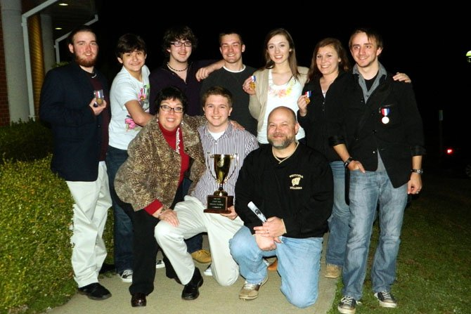 The Oleanna cast and crew with their trophy and medals (front row, from left): Theater Director Susie Pike, play director Joey Biagini and Westfield Principal Tim Thomas; (back row, from left) Perry Cowdery, Alex Mann, Joe Drzemiecki, Mitchell Buckley, Madeleine Bloxam, Allie Koenigsberg and Dieter Stach. (Not pictured: Corinne Holland.)