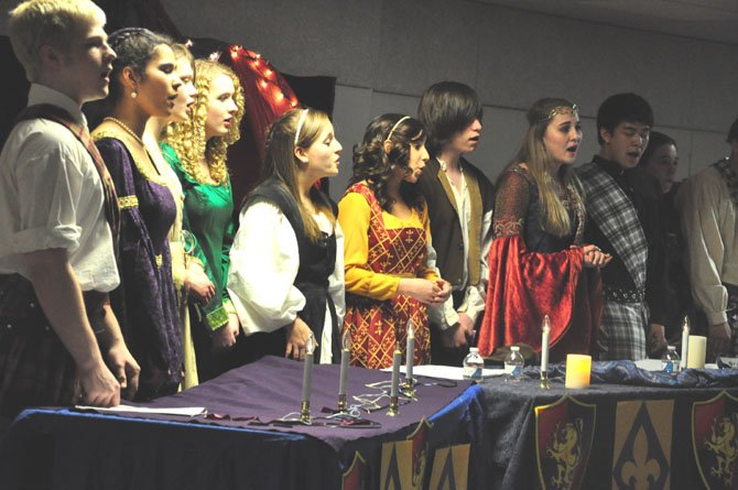 Members of the McLean High School Madrigals perform in the choral department's annual Boar's Head Feast at the school Saturday, March 10.