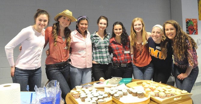 Allison Klem, Eva Muszynski, Tricia Leano, Caroline Keating, Frankie Zito, Gennie Gilson, Clara Balestrieri and Anna Merlene help out with the refreshments during a break in the dance.