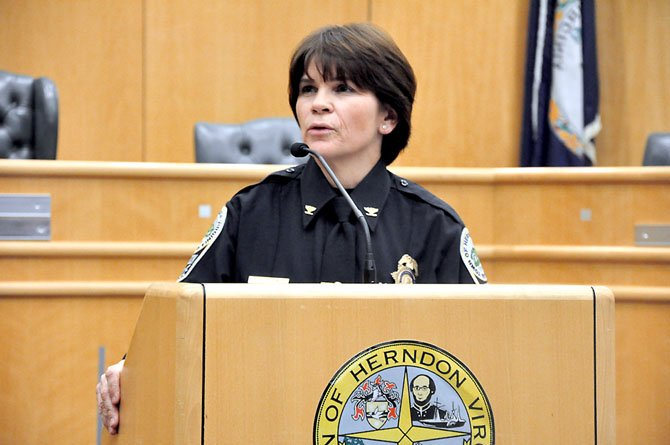 Col. Maggie A. DeBoard, Chief of the Town of Herndon Police Department, addresses town residents and staff after being sworn in Tuesday, March 6.