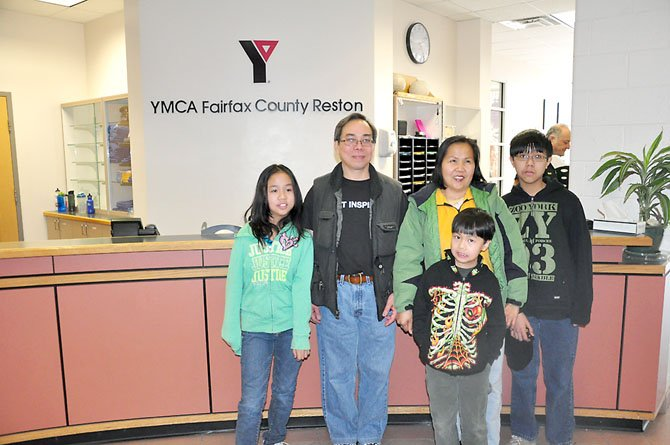 From left, Tiffany Ngoc Thuan Thai, 11, Trung Anh Van Thai, Phoung Nga Thi Tran, Stewart Trung Thang Thai, 9 and David Trung Tien Thai at the Reston YMCA Saturday, March 10. The family was one of several that were awarded YMCA memberships through the YMCA and a partnership with Reston Interfaith.