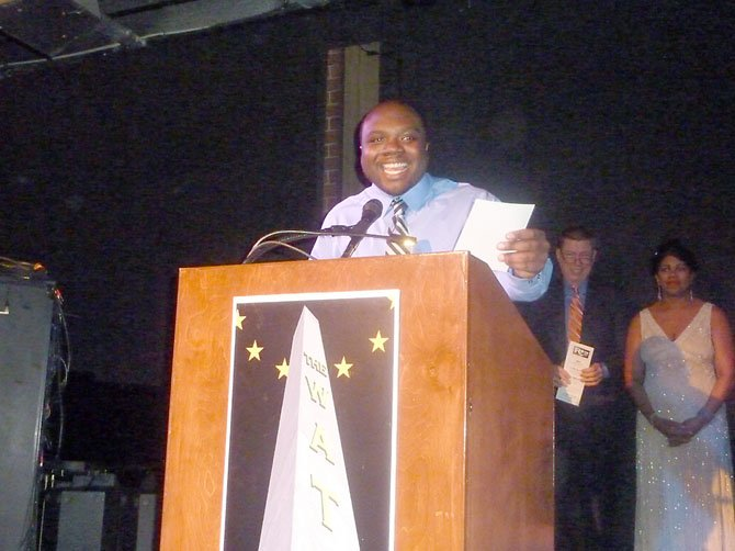 "Christopher Prince accepts the award for Best Featured Actor in a Musical for his role as Ken Page in the ESP production of ""Ain't Misbehavin'."""