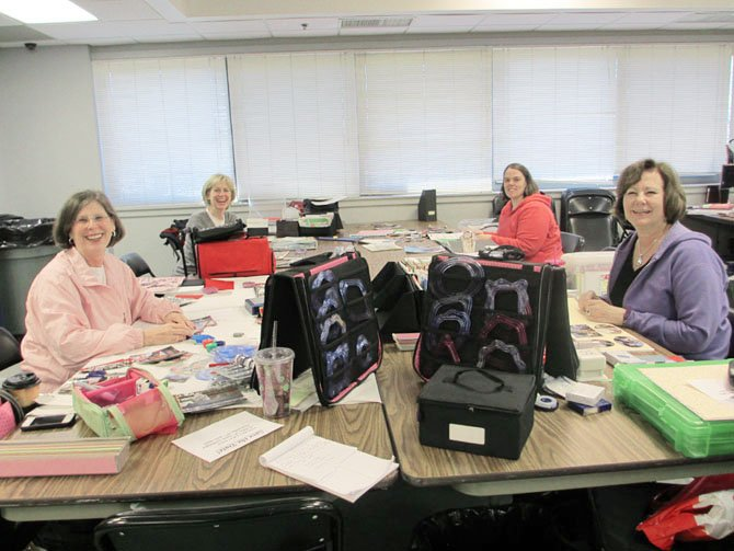 Scrapbooking friends Brenda Belote, Judy Barto, Marnie Sturm and Sherry Hayden look forward to dedicating a weekend to socializing with like-minded hobbyists.