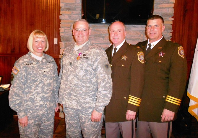 Deputy William L. Morgan, second from left, is joined by Brigadier General Leslie Purser, Undersheriff Tony Davis and Chief Deputy Tony DiCesare at Fort Eustis, Va., March 4 to celebrate his retirement from the U.S. Army Reserves after 31 years of service.