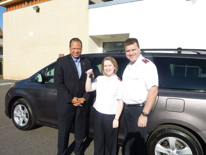 Alexandria Salvation Army board chairman Walter Clarke, left, joins Lieutenants Sherri and Trey Jones March 9 in celebrating the acquisition of a new van from Jack Taylor's Toyota. The Corps won the van by logging the most volunteer hours in the DC region during the 2011 Red Kettle Campaign.