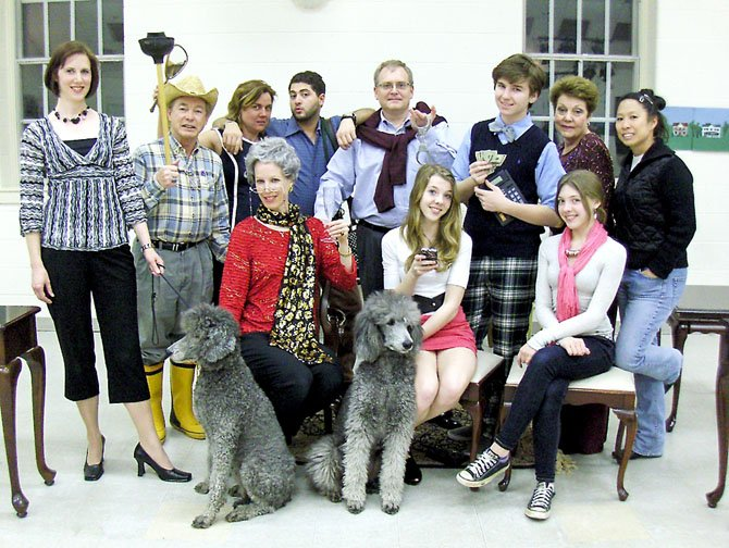 "The cast of ""Maid for Dogs,"" (standing, from left) Stephanie Lawrence, Charles Hoffman, Elizabeth Vittori, Walid Chaya, Jim Manchester, Maxwell Snyder, Helen Rusnak and Charlotte Yakovleff, and (sitting, from left) Lynne Strang, Andie Matten and Roxy Matten. Dogs are Abby and Izzy."